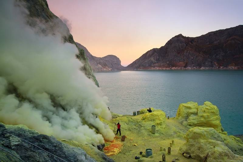 Extracting sulphur inside kawah ijen crater.